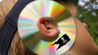 Woman wearing a pirated CD around ear, symbolizing listening to arguments